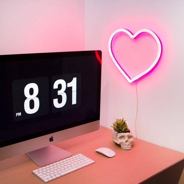 pink neon heart in home office
